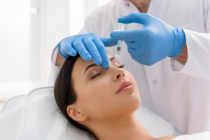Woman Getting Juvederm Injections Into Nose