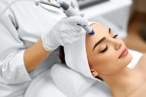 Woman Undergoing Microdermabrasion